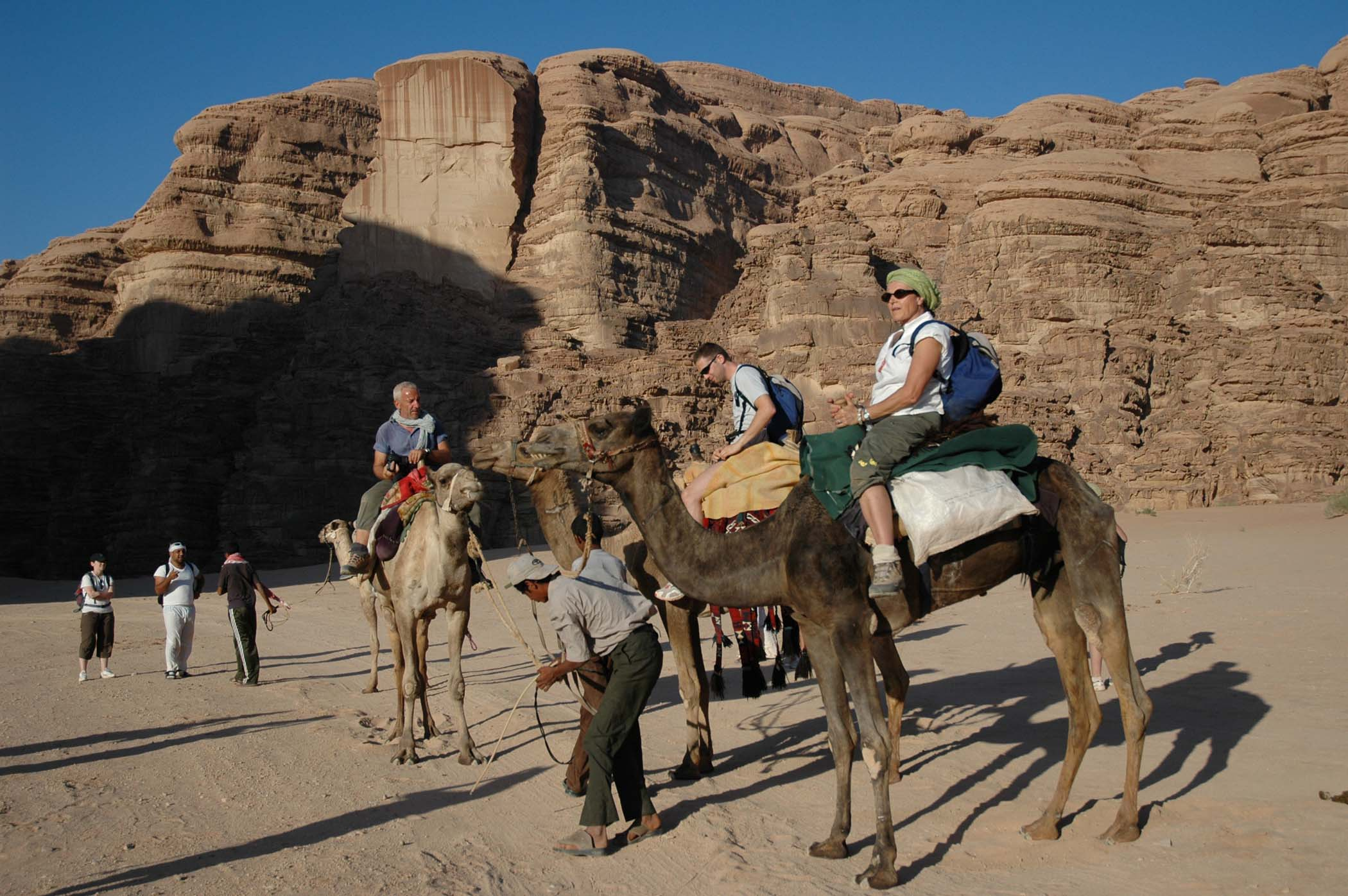 JORDAN Wadi Rum Camel Riding Tourists.jpg